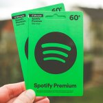 two green spotify gift cards