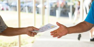 person giving someone a card