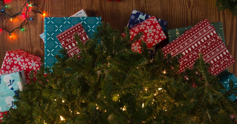 holiday presents by tree