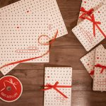 gifts wrapped with red ribbon